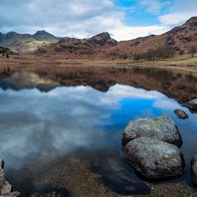 Reflections of the Langdales by Andy Young - Landscapes Waterscapes ( langdales, uk, cumbria, blea tarn, reflections, rocks, lake district )