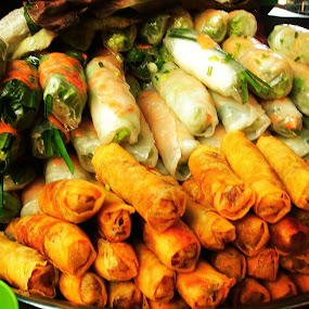 Mountains of Spring rolls , Cambodia  by Minami Kojima - Food & Drink Plated Food ( spring roll, local market, travel, cambodia )