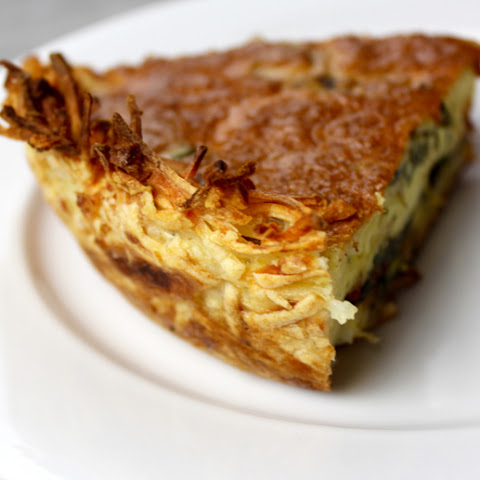 Cheesy Tomato Mixed Greens Quiche with Hash Brown Crust