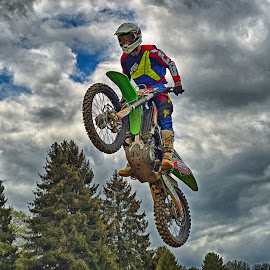 Standing Jump by Marco Bertamé - Sports & Fitness Motorsports ( clouds, speed, number, yellow, 961, race, noise, jump, flying, red, motocross, blue, standind, grey, air, high )