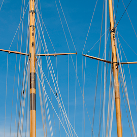 Masts of yachts by Deyan Georgiev - Transportation Boats ( port, curve, nobody, harbor, freedom, bright, ship, yacht, brightly, ocean, equipment, travel, recreation, cruise, clear, mast, adventure, sky, nature, rope, mediterranean, lifestyle, rigging, power, sail, directly, maritime, water, abstract, wind, vessel, waves, white, sport, sea, sailboat, boat, angle, luxury, holiday, vacation, yachting, blue, background, summer, wealth, day, success, nautical, competition )