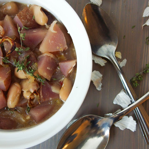 White Bean Stew with Caramelized Shallot, Roasted Garlic, and Purple Potato