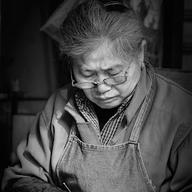 The Sewing Lady by Freddy Ng - People Street & Candids ( old lady, black and white, wet market, shanghai, seamstress, china )
