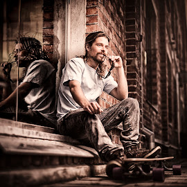 by Jan Kraft - People Portraits of Men ( brick wall, casual, male, reflections, male portrait, longboard, norway )