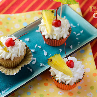 Piña Colada Cupcakes with Coconut Rum Cream Cheese Frosting