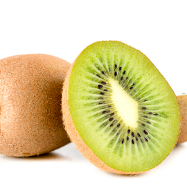 Kiwi by Robert  Płóciennik - Food & Drink Fruits & Vegetables ( plant, juicy, single, diet, tropical, object, circle, exotic, macro, kiwi, vegetarian, wet, closeup, dessert, isolated, fruit, texture, green, seed, agriculture, snack, section, organic, tasty, nutrition, sweet, color, food, background, ripe, healthy, eating, vitamin, part, natural )
