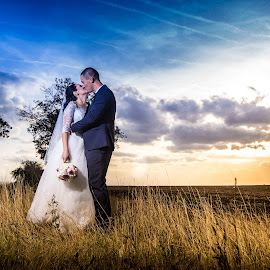 Kiss of love! by Doru Iachim - Wedding Bride & Groom ( love, kiss, grass, sunset, wedding, sunrise )