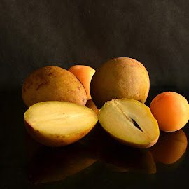 sapota and plum by Prasanta Das - Food & Drink Fruits & Vegetables ( fresh, cut, sapota, plum )