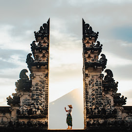 Sunrise at Bali well known temple gates in Lempuyang Temple by Awi Deskabelly - Buildings & Architecture Places of Worship ( young, cliff, surfing, summer, sea, beautiful, bali, vacation, sky, surfer, surf, kuta, nature, asia, natural;, shore, indonesia, water, people, outdoor, tropical, coast, sand, sunlight, ocean, background, person, beach, sunset, silhouette, travel, fun )