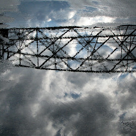 After The Storm by Dale Minter - Abstract Patterns ( clouds, water, reflection, puddle, sidewalk )