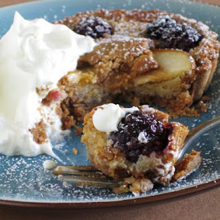 A Tart With Pears And Blackberries