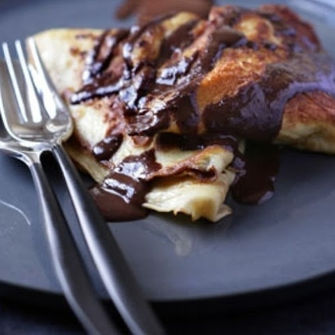 Walnut Filled Pancakes With Chocolate Sauce