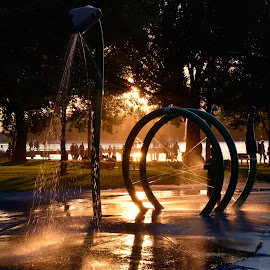 Sunset In The Park by Garry Dosa - City,  Street & Park  Fountains ( waterdrops, outdoors, dusk, sunset, waterspray, playground, fountains, people, summer,  )