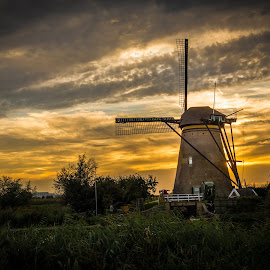 by Kevin Warrilow - Buildings & Architecture Public & Historical ( water, canals, sunset, kinderdijk, holland, windmills )