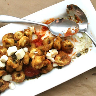 Fried Tortellini with Roasted Garlic Tomato Sauce & Pesto Oil