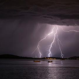 Anyone for a boat ride? by Jernej Lipovec - Landscapes Weather ( sony, thunder, lightning, nature, waterscape, šibenik, croatia, sea, weather, landscape, storm, boat )
