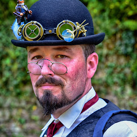 The Teacher by Marco Bertamé - People Portraits of Men ( glasses, 2016, goggles, beard, dond-de-gras, steampunk, black, eyes, hat, luxembourg )