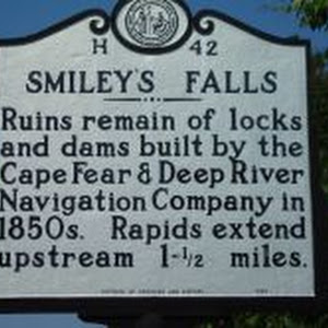 Ruins remain of locks and dams built by the Cape Fear & Deep River Navigation Company in 1850s. Rapids extend upstream 1- 1/2 miles.Plaque via North Carolina Highway Historical Marker Program, and is ...