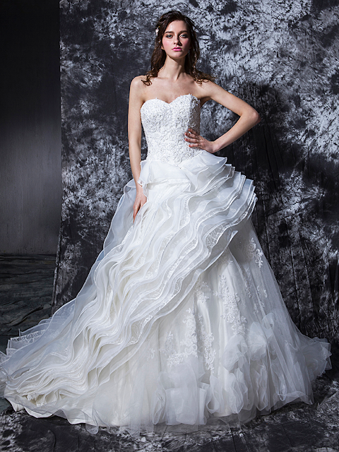 The Skirt Is Semi Overlaid With Frills Of Organza Lace And Tulle These Features Are Complemented Floral Guipure Appliques Gown Includes An Inner