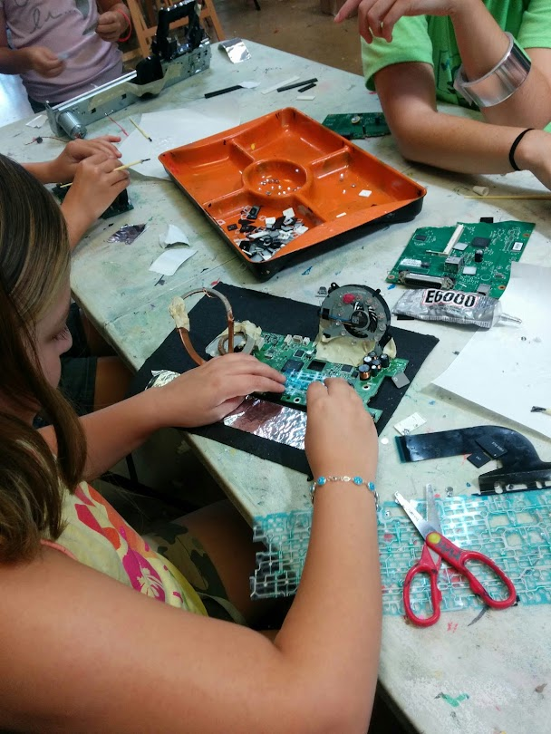 Students using recycled computer parts to create 3D sculptures and works of art.