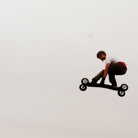 enjoying the flight by Claudia Romeo - Sports & Fitness Skateboarding ( longboard, beach, skateboard )