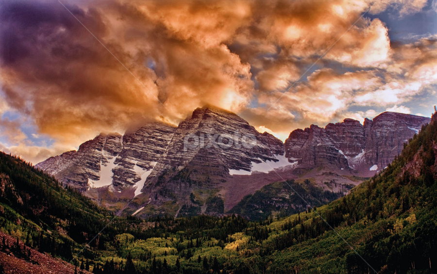 Maroon Bells Sunset by Brian Kerls - Landscapes Mountains & Hills ( destinations, mountain, fall colors, travel, hiking, alpine, sky, iconic, tree, nature, autumn, camping, light, orange, evergreens, snowmass, forest, tourism, beauty in nature, dusk, landmark, outdoors, 14er, trees, maroon bells, natural, outside, peak, back packing, landscape, aspen, mountains, conservation, dramatic, aspens, autumn colors, colorado images, evening, clouds, colorado, scenic, environmental, wilderness, sunset, fall, summit, landscapes, peaks, hike )