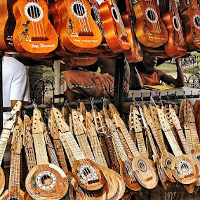 The Guitar Salesman by Bob White - Artistic Objects Musical Instruments ( shop, market, musical instrument, cebu, guitar, guitars, philippines,  )
