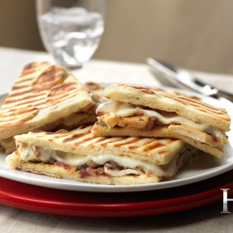 HELL'S KITCHEN Caramalized Onion, Grilled Chicken and Provolone Naan Panini