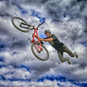 Flying With My Bike by Marco Bertamé - Sports & Fitness Other Sports ( clouds, flying, red, blue, grey, air, high, dow, stunt, luxembourg,  )