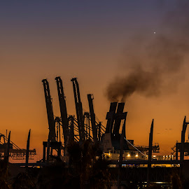 Sunset in Barcelona. by Liam Coburn Dunne - City,  Street & Park  Skylines ( nikon 24-70, orange, cranes, nikon d800, silhouette, sunset, harbour, black & orange, docks, smoke,  )