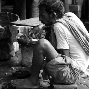 Hunger by DrArindam Ghosh - People Street & Candids ( street candids, black and white, street, bw, street photography )