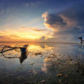 The Landscaper by Arya Satriawan - Landscapes Sunsets & Sunrises ( water, clouds, reflection, nature, color, sunset, seascape, boat, landscape, people )