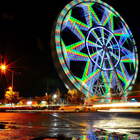 Broken Reflection by Wilbert Quebral - City,  Street & Park  Street Scenes ( ferris, wheel )