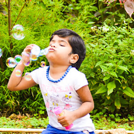 blowing bubbles by Sindhuja Subburaj - Babies & Children Children Candids ( #photography_of_my_life, #kiddish, #colours_scintilating, #bubbles_love, #nature_shower )