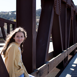 Girl on a bridge by Paula Garcia - Babies & Children Children Candids ( contrast, backlit, long hair, bridge, yellow )
