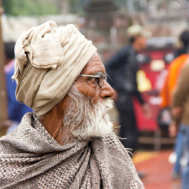 An old Man by Amit Aggarwal - People Portraits of Men ( old, market, shawl, winters, turban, white, khajuraho, beard, india, travel, side pose, man, aged )