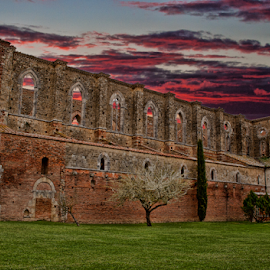 S.Galgano (Tuscany, Italy) by Gianluca Presto - Buildings & Architecture Places of Worship ( nobody, old, gothic, tuscany, arch, architecture, historic, story, sky, ancient, italia, dark, buildings, italy, abbey, building, church, toscana, green, quiet, red, legend, sunset, arches, architectural, cathedral, sunrise, medieval, abandoned, decay )
