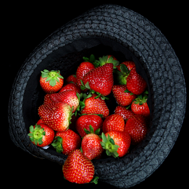 Hat full of strawberries by Dipali S - Food & Drink Fruits & Vegetables ( raw, people, crop, colour, farm, super food, berry, dried, nature, fresh, antioxidant, vegetarian, wet, vitamin c, objects, closeup, dessert, water, fruit, sour, green, fruits, vegetables, agriculture, health, snack, strawberry, nutrition, organic, red, sweet, blue, color, food, ripe, healthy, cultivated, eating, freshness, group, vitamin )