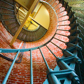 Lighthouse spiral staircase. by Gale Perry - Buildings & Architecture Architectural Detail ( interior, spiral staircase, turquoise, red brick wall, lighthouse, looking up,  )