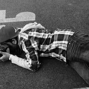 by Maya Farebrother - People Portraits of Men ( lying, floor, camera, checks, photo )