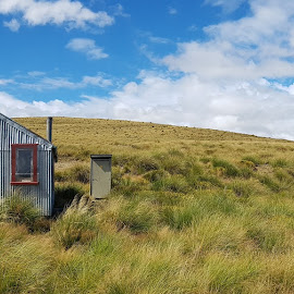 Walking New Zealand by Perla Tortosa - Landscapes Travel ( clouds, accomodation, mountains, sky, walks, nature, blue, camping, hut, tussocks, new zealand,  )