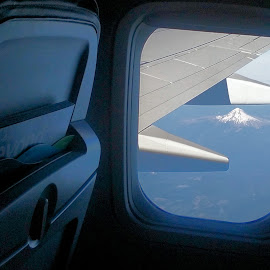 Mountain from Boeing passenger jet by Christopher Barker - Instagram & Mobile Android ( mountain, airplane, mountain from airplane window )