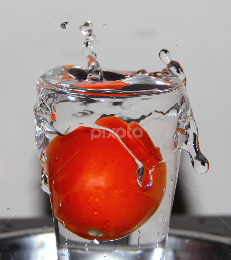Tomato in a glassTomotos... by Shrikrishna Bhat - Food & Drink Fruits & Vegetables ( water, tomato, food, glass, ganesha, , Food & Beverage, meal, Eat & Drink )