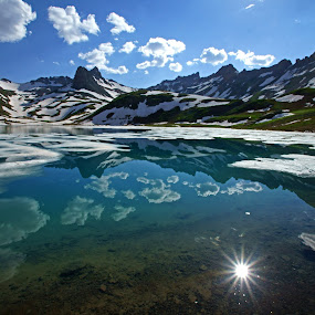 Ice Lake Sun Flare by Justin Giffin - Landscapes Mountains & Hills ( clouds, san juans, mountains, waterscape, ice, rocky mountains, colorado, reflections, lake, sun flare, landscapes, silverton,  )