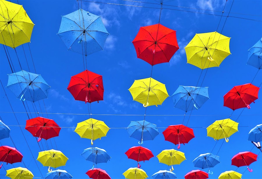Colourful umbrellas by street by Svetlana Saenkova - Digital Art Things ( street art, blue sky, colourful, umbrellas,  )