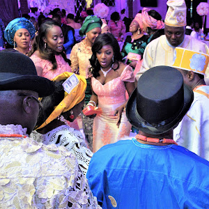 DJ-BLITZ ENTERTAINING THE BRIDE AND GROOM IN THERE NIGERIAN TRADITIONAL ATTIRE