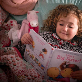 Big Sis Training by Mike DeMicco - Babies & Children Child Portraits ( reading, bed, little, pretty, bedtime, training, sister, love, sisters, curly, new, sis, sweet, girl, book, night, baby, big, hair )