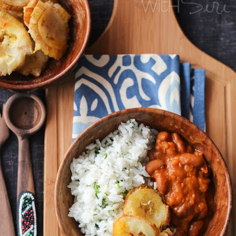 Garlic Tostones | Puerto Rican Twice Fried Plantains With Rice and Beans