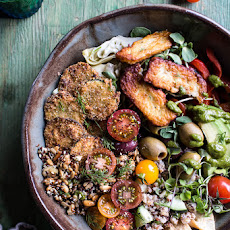 Greek Goddess Grain Bowl with Fried Zucchini, Toasted Seeds and Fried Halloumi.