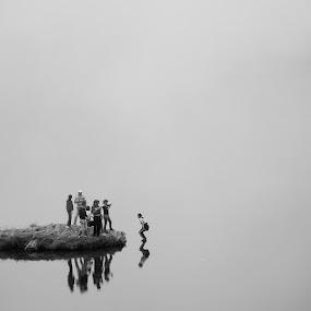 Jump by Emil Zaman - Black & White Portraits & People ( haze, black and white, lake, symmetry, people, jump )